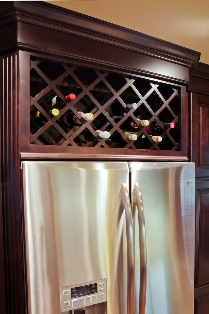 Gallery red river remodelers wine rack built in above refirgerator dark expresso cabinets