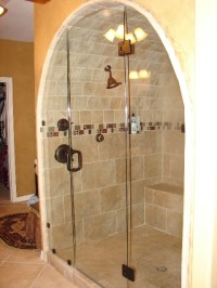 copper shower fixture in arched shower area | Bathroom ...