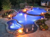 Natural edge pool with spa, slide and waterfall by ...