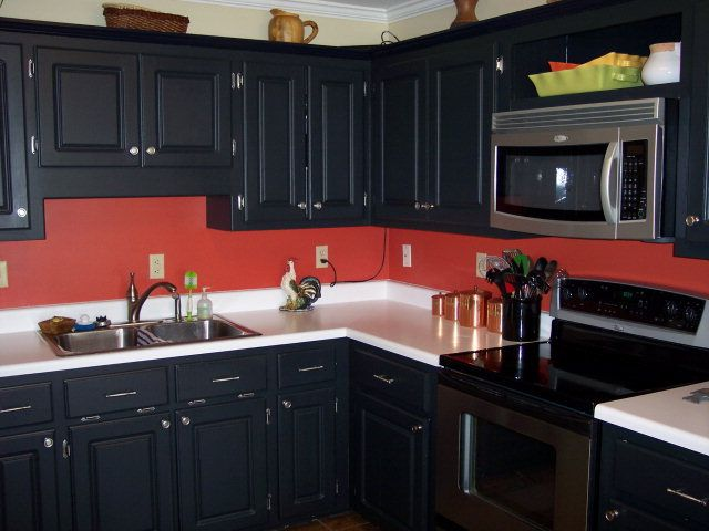 Red And Black Kitchen Black Cabinets & Red Walls. Its Definitely A Maybe For My