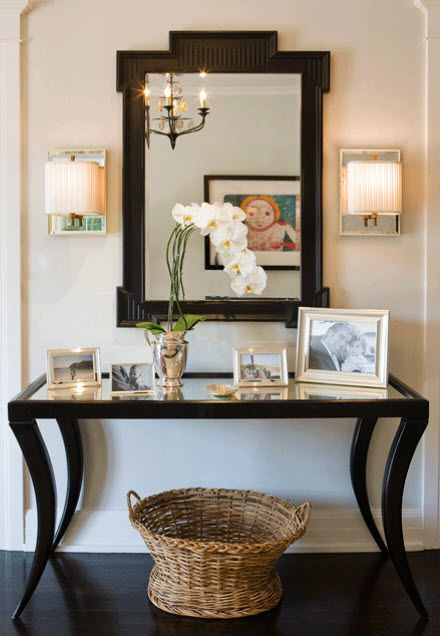 Chic foyer with black mirrored top console table with