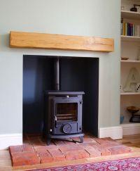 AGA wood burning stove installed on brick hearth ...