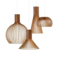 bent wood contemporary chandelier over dining table ...