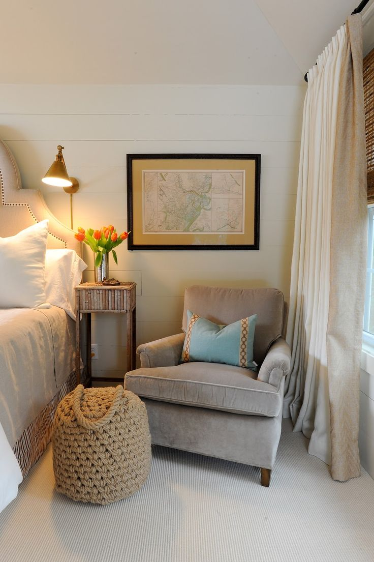 A cozy club chair adds warmth to a master bedroom chair on one side and