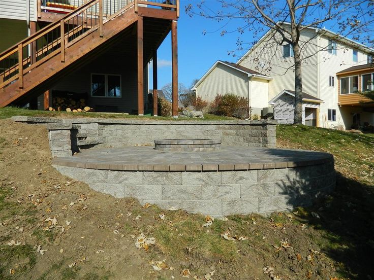 fire pit on hillside with retaining walls above and below