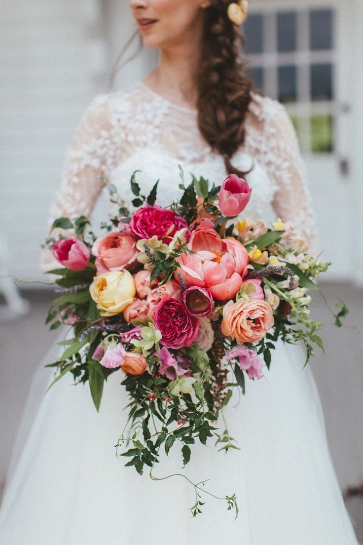 wedding bouquets wedding bouquet Lush cascading bridal bouquet with coral peonies peach ranunculus and pink tulips