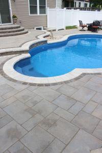 This Massapequa, NY pool patio, built with beautiful ...