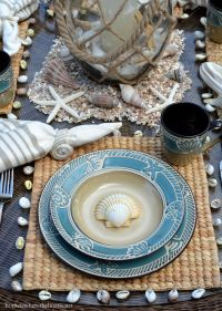 Beach-themed table with shells and Pfaltzgraff Montego ...