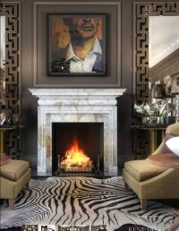 mantel...large mirrors flanking either side of fireplace ...