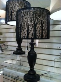 """Table lamp with """"tree branch"""" cut outs on shade. Very cool ..."""