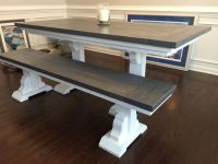 This farmhouse table and bench feature a vibrant white ...