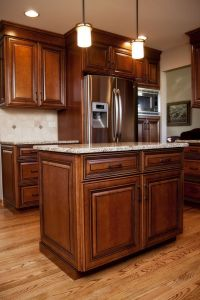 Beautiful maple stained cabinets with black glaze in this