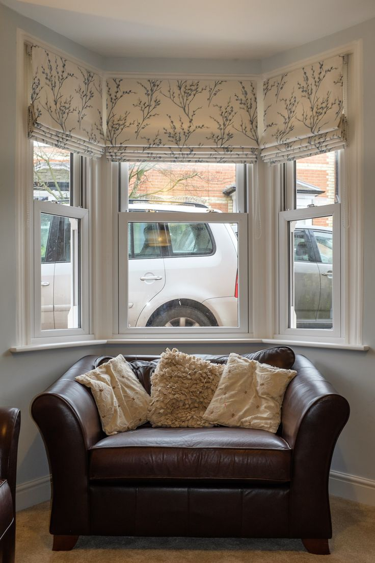 Three roman blinds to dress a bay window the fabric is by laura ashley pussy