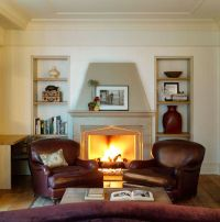 Leather club chairs flanking fireplace. | Rice Place ...