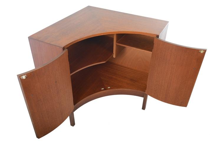 English modern mid century corner cabinet in teak.