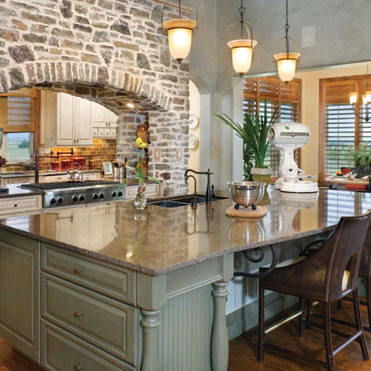 Kraftmaid Kitchen Island With Seating Rustic Kitchen With Brick Arch And Double-sided Stove