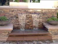 how to decorate a waterfall wall hanging over pool ...