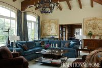 A blue bauble chandelier dazzles above a living room with ...
