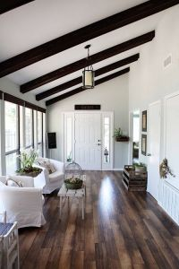 hard wood floors and white walls with dark wood on ceiling ...
