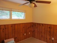Half-wall painted wood paneling treatment. Certainly more ...