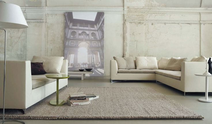 Minimalist Urban Loft Living Room with Cream Sofas and Light Brown - brown rugs for living room