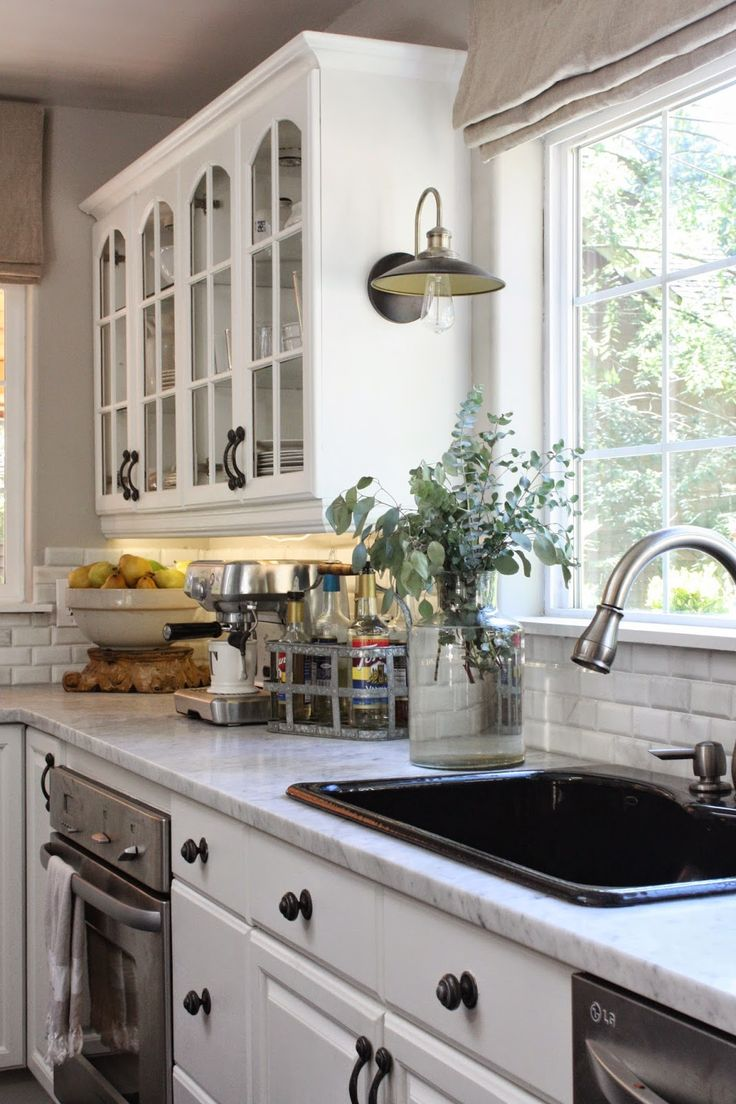 black sink sink kitchen cabinets Fall home tour pretty kitchen I really like the light next to the sink