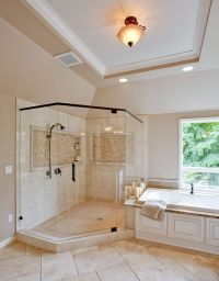 Traditional Master Bathroom with specialty window ...