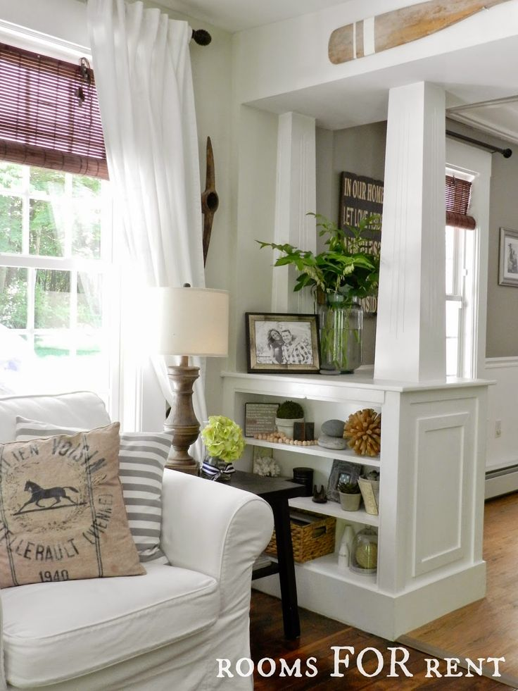 White columns with built in shelves . . . great to divide
