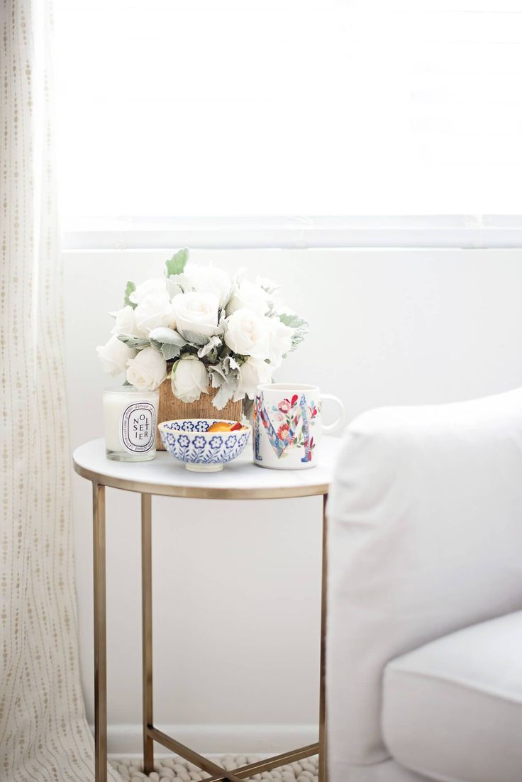 Quiet mornings at home marble side table with flowers and coffee