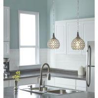Interior designers often use pendant lights in the kitchen ...