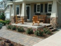For renovated rancher--add rock based pillars and extend ...
