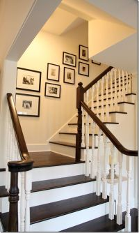 painted white stair risers balusters with dark wood rails