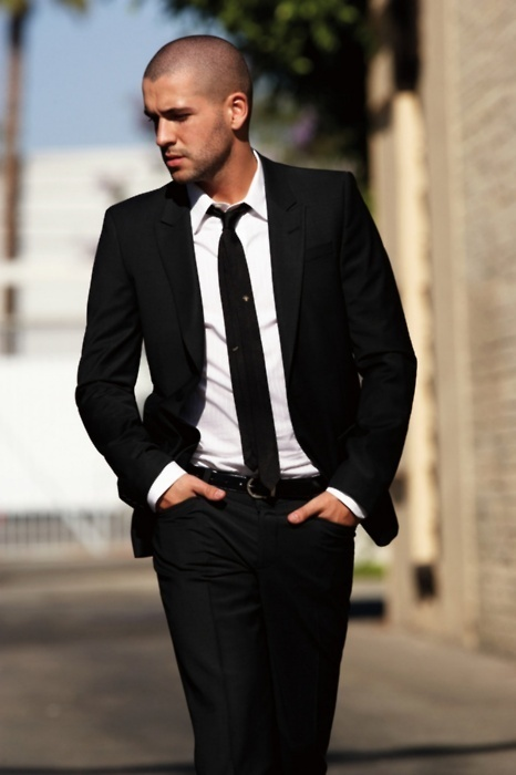 black suit and skinny tie.