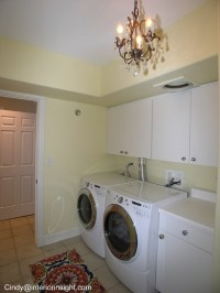 cute utility / laundry room room with light fixture ...