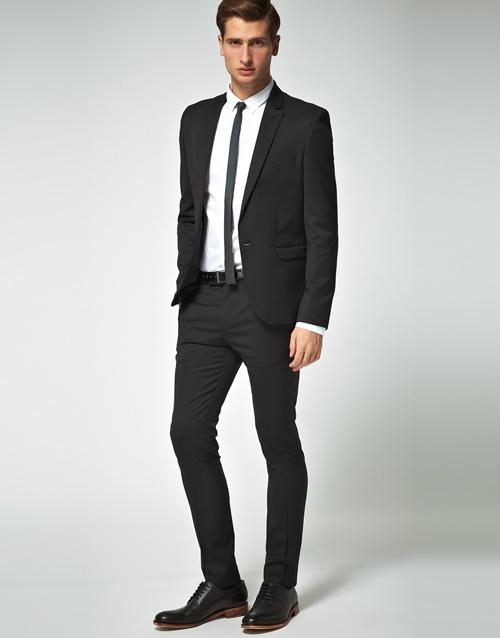 Black suit, skinny tie.