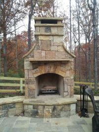 Outdoor Stone Fireplace with Hearth and Seating Wall ...