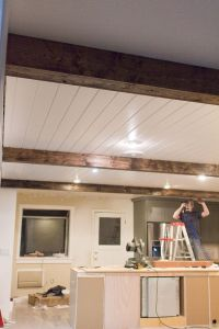 DIY Faux Wood Beams ... really cool idea how she made them ...