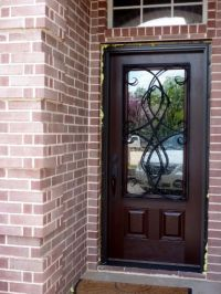 pella door with wrought iron