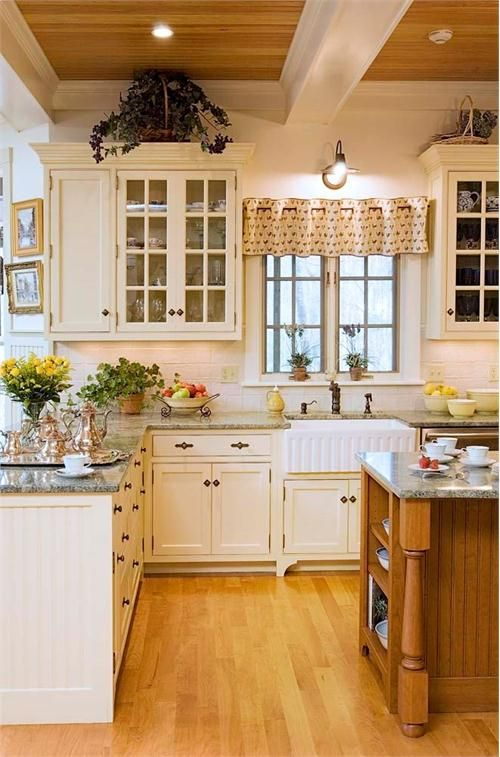 Cream Colored Kitchen Island White Country Kitchen By Crown Point Cabinetry On