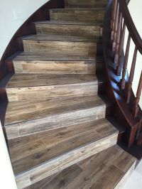 Wood looking tile with newly stained banister | Porcelain ...