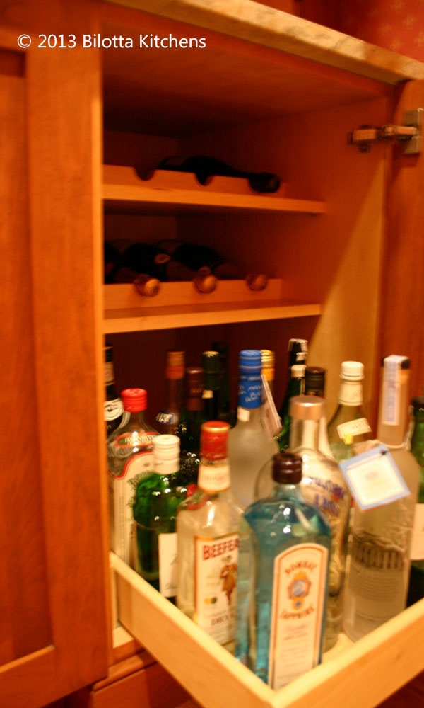 Deep Kitchen Cabinet Storage Ideas Roll-out And Inserts For Bottle Storage In A Liquor