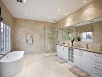 Modern bathroom design with freestanding bath using chrome ...