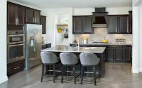 This gourmet kitchen with large walk-in pantry is open to ...