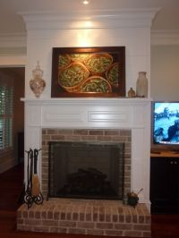 Traditional Brick Fireplace. Raised hearth. Paneling above ...