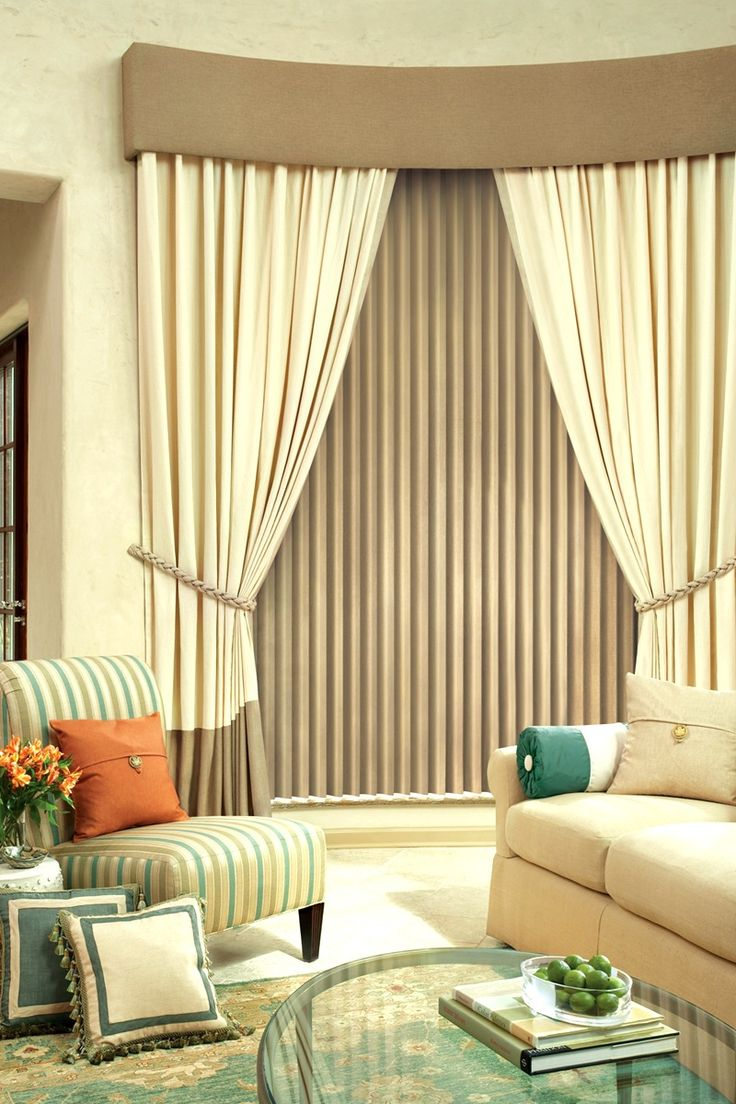 Vertical blinds with panels and tie backs give the room a sophisticated look