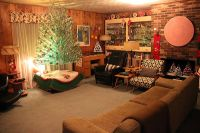 Mid century modern, wood paneled, family room decorated ...