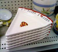 A set of six ceramic pizza-slice plates.   Dishware ...
