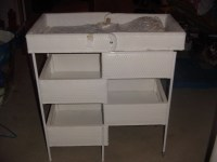 We got a vintage folding wicker changing table like this ...