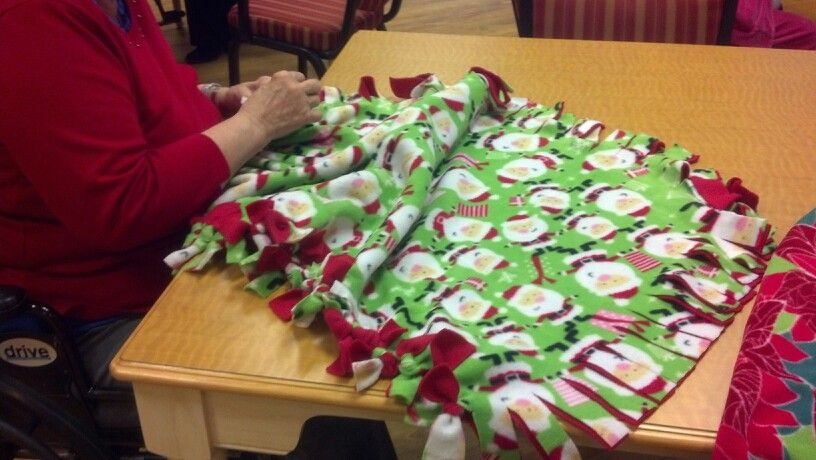 Residents of a nursing home engaged in making lap throws2 - nursing home activity ideas