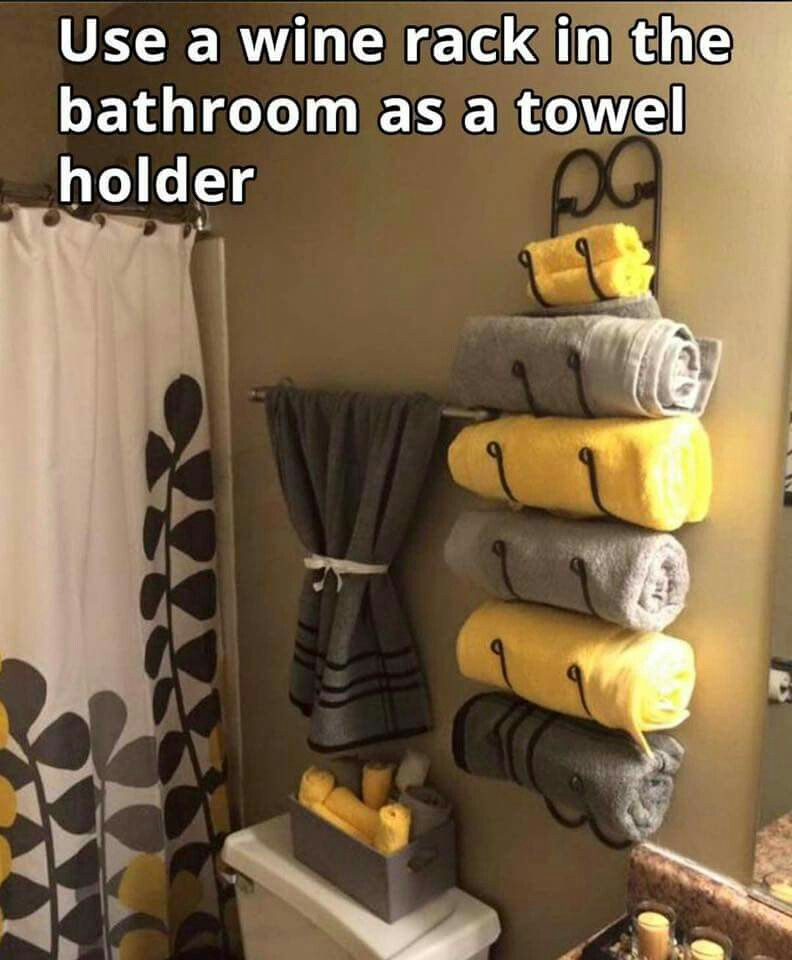 Awesome idea to use a wine rack as a towel rack in the bathroom - decorating ideas for small bathrooms